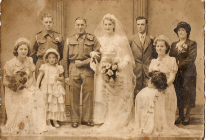 Unknown wedding with Frederick Walter Beacock and Lily Kirby on the right of the back row.